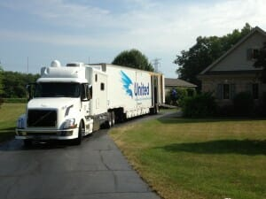 moving truck parked outside home for loading