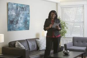 lady performs in-home survey for moving