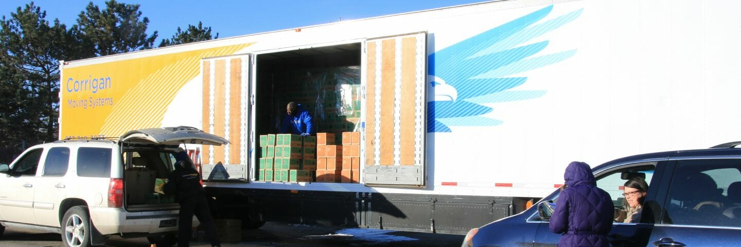 suv loading girl scout cookies into trunk from side doors of trailer