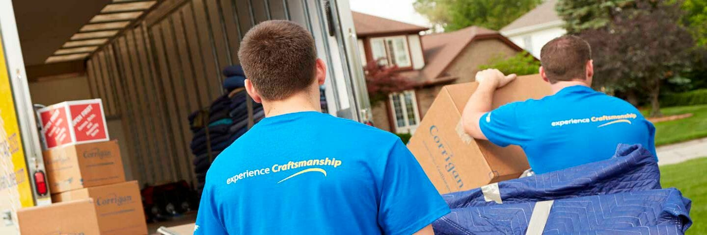 local movers loading boxes and furniture into moving van