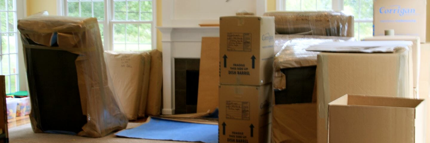 household good packed and wrapped in paper pads ready for an international move