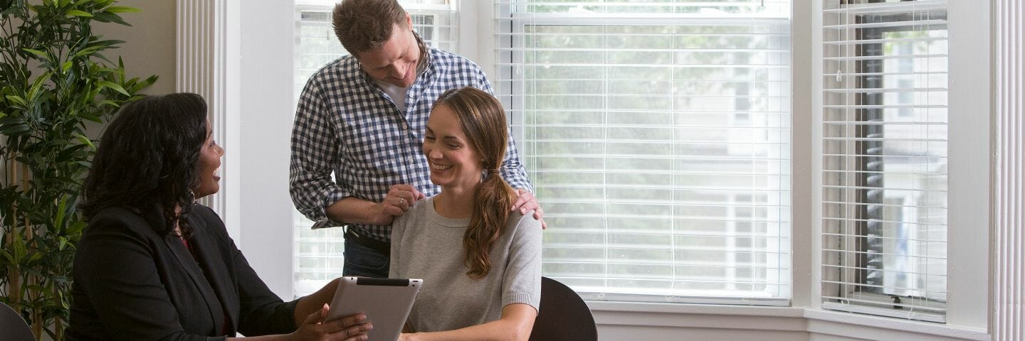 move consultant sits with couple in their home