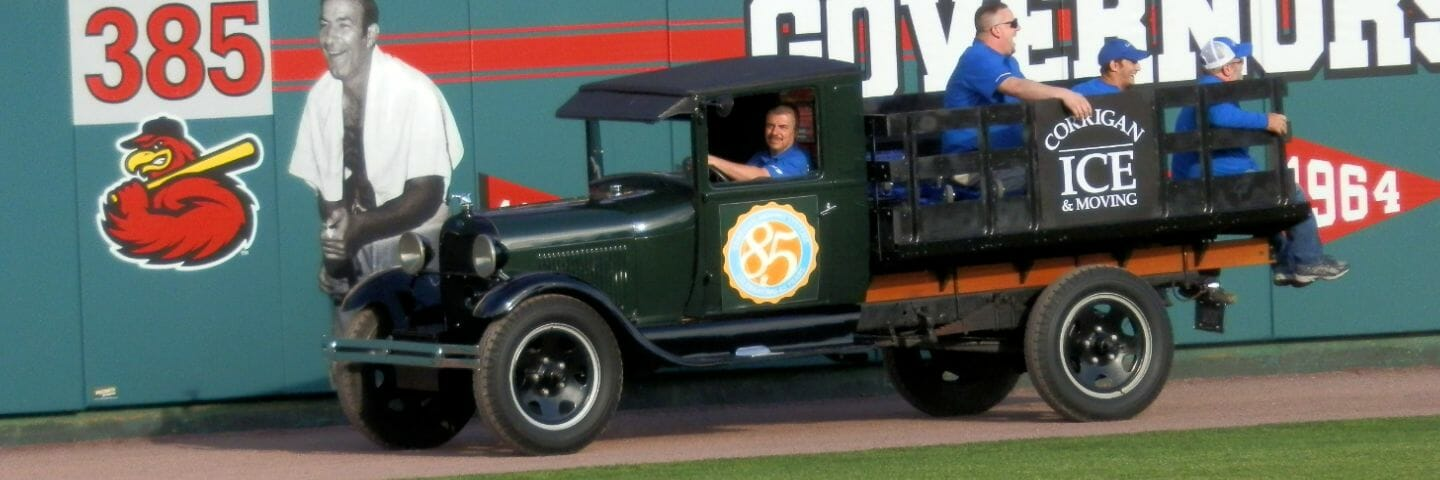 1929 ice delivery truck driving in the outfield of the Rochester Red Wings field